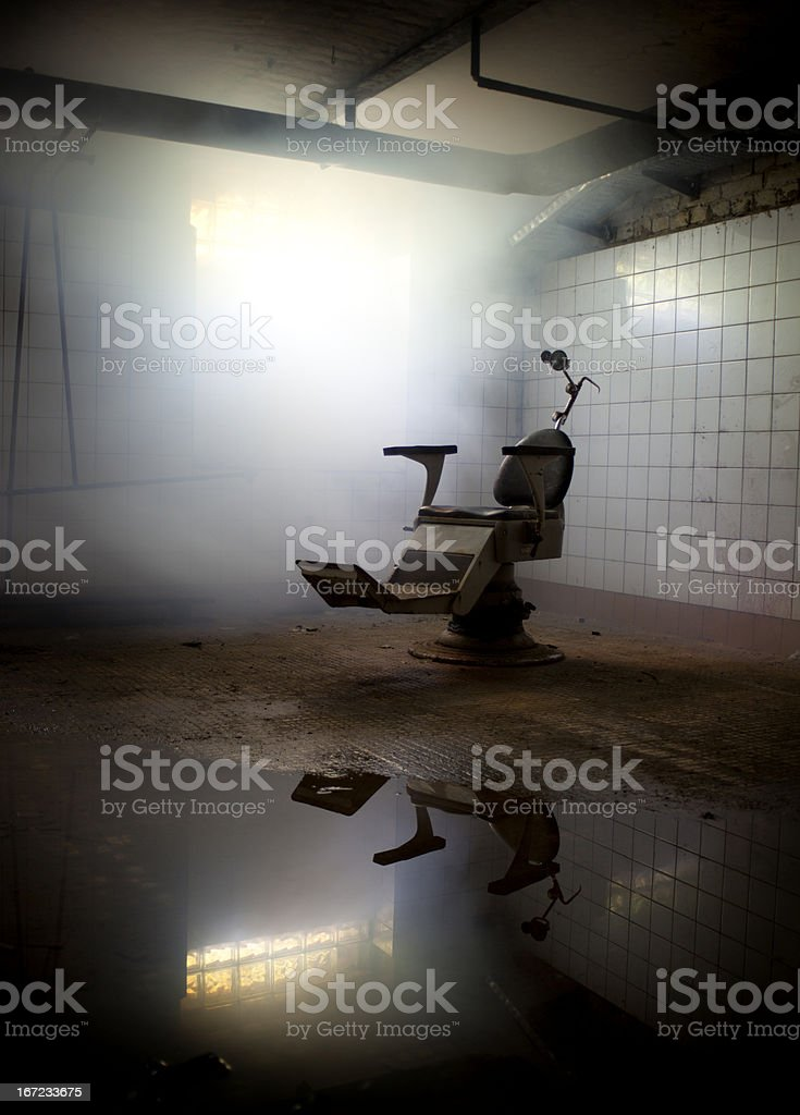 Photograph of an old dentist's chair in an abandoned room stock photo