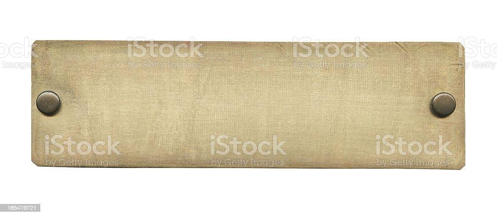 A photograph of an old rectangular brass plate stock photo