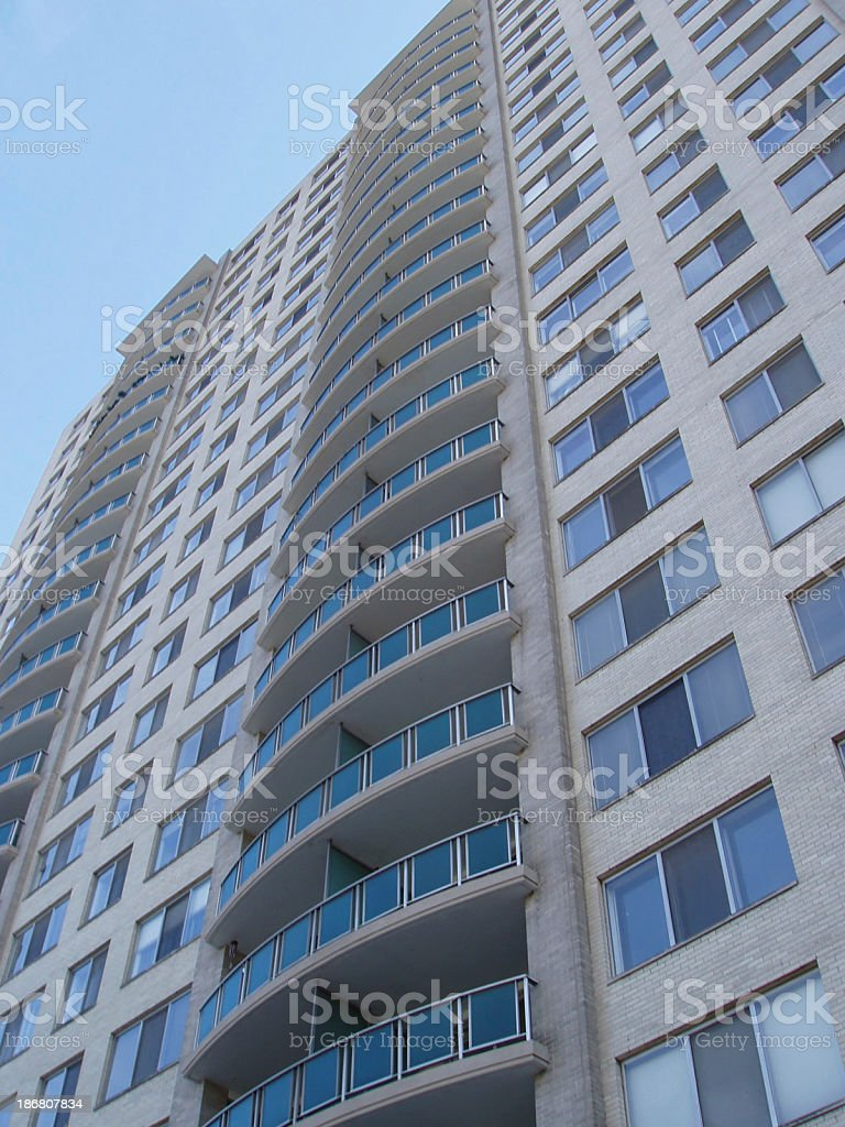 A photograph of an urban apartment building stock photo