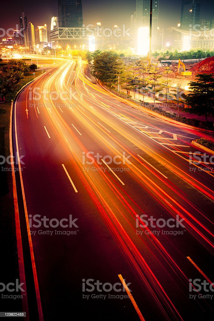 A photograph of blurred traffic on a busy freeway royalty-free stock photo