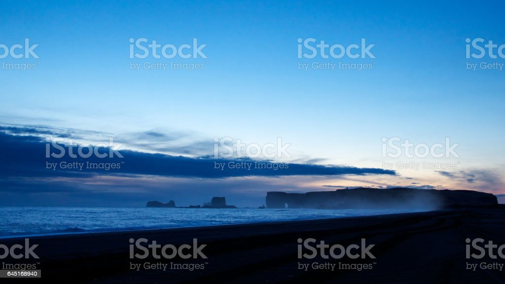 Photograph of Cape Dirholaey and Reynisfjara beach during sunset, Iceland stock photo
