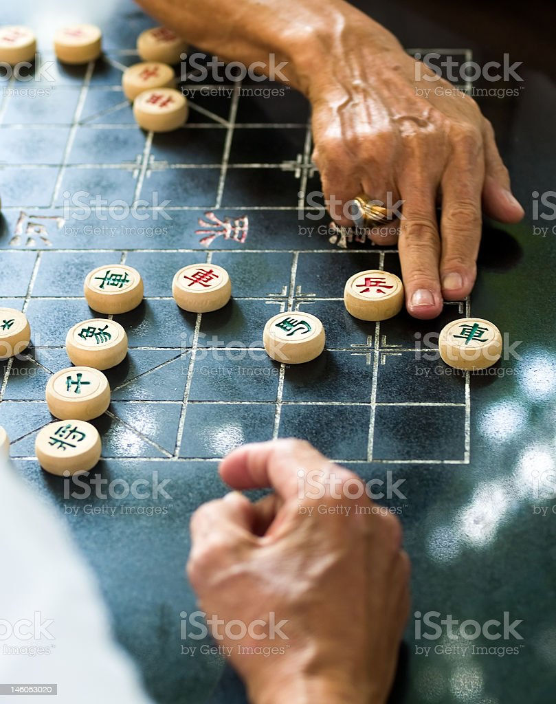 Photograph of elderly people playing a Chinese strategy game stock photo