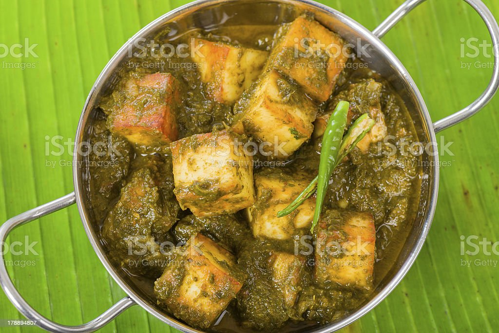 Photograph of palak paneer in a stainless steel pot  stock photo