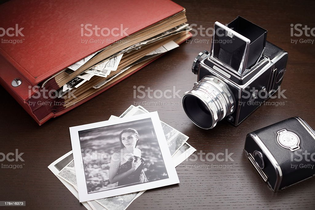 Photograph of retro styled cameras and photos stock photo