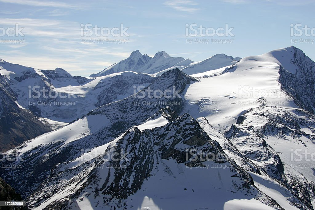 Photograph of snow covered mountain range royalty-free stock photo