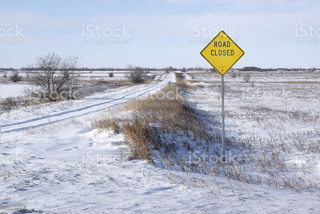photograph of snow-covered prairie road royalty-free stock photo
