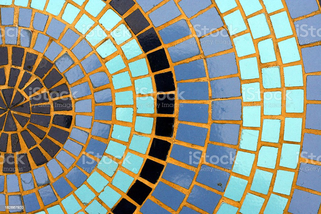 A photograph of some blue mosaic tiles forming circles royalty-free stock photo