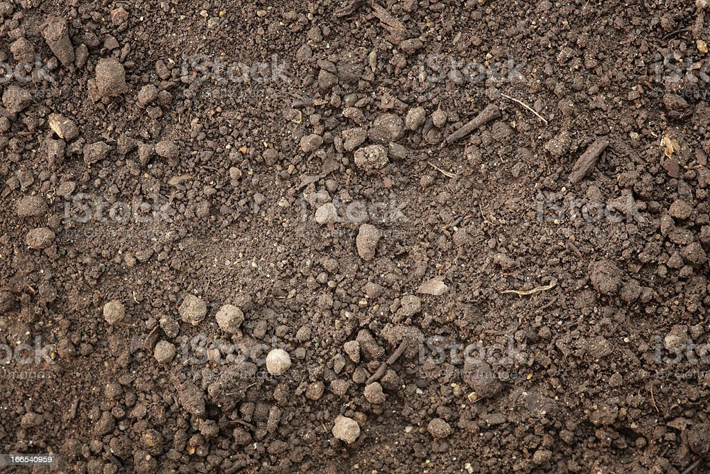 A photograph of some brown dirt and stones stock photo