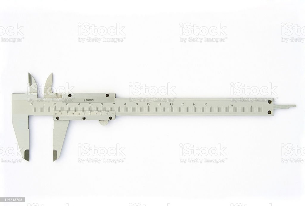 A photograph of some cream colored calipers on paper stock photo
