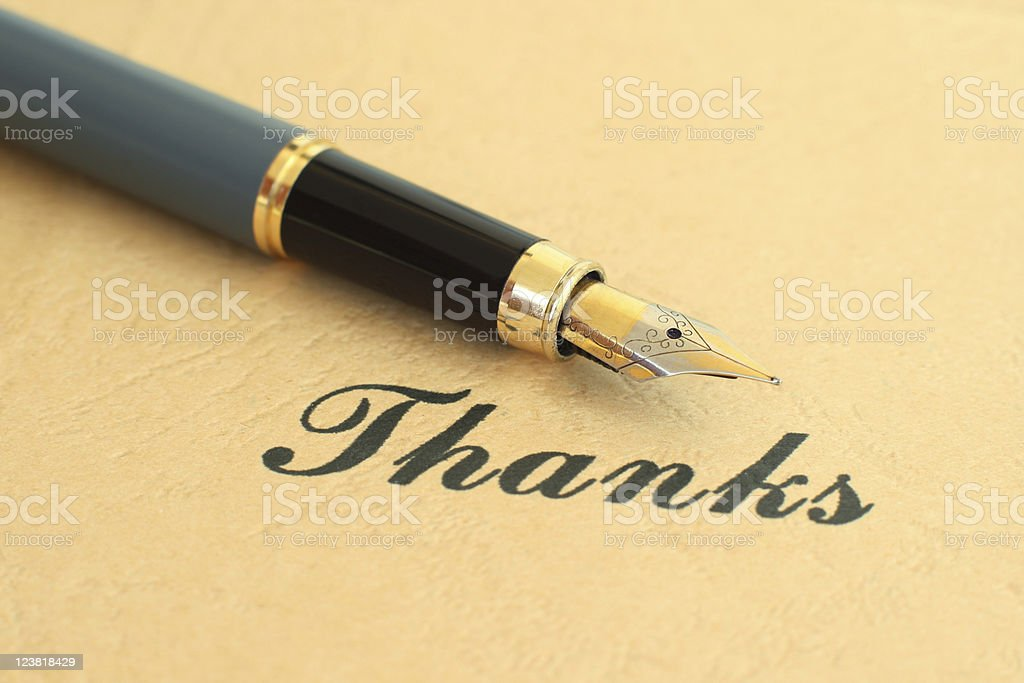 Photograph of thanks and a calligraphy pen royalty-free stock photo