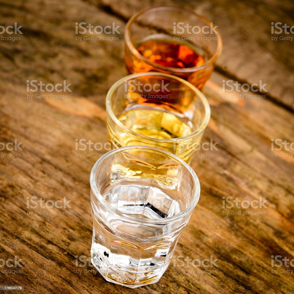 Photograph of three glasses containing alcoholic beverages stock photo