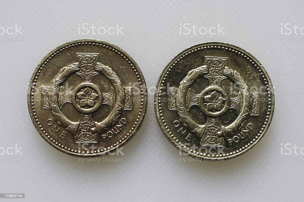 British pound coins 2001 and 1996 Celtic reverse sides comparison royalty-free stock photo