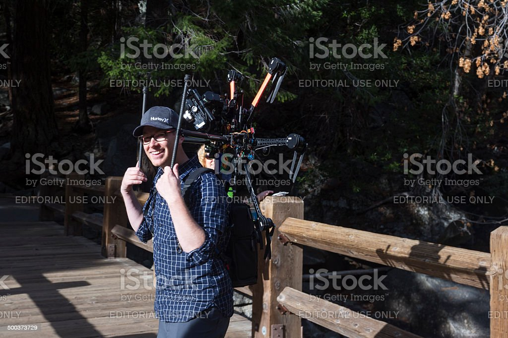 Photographer and hexacopter stock photo