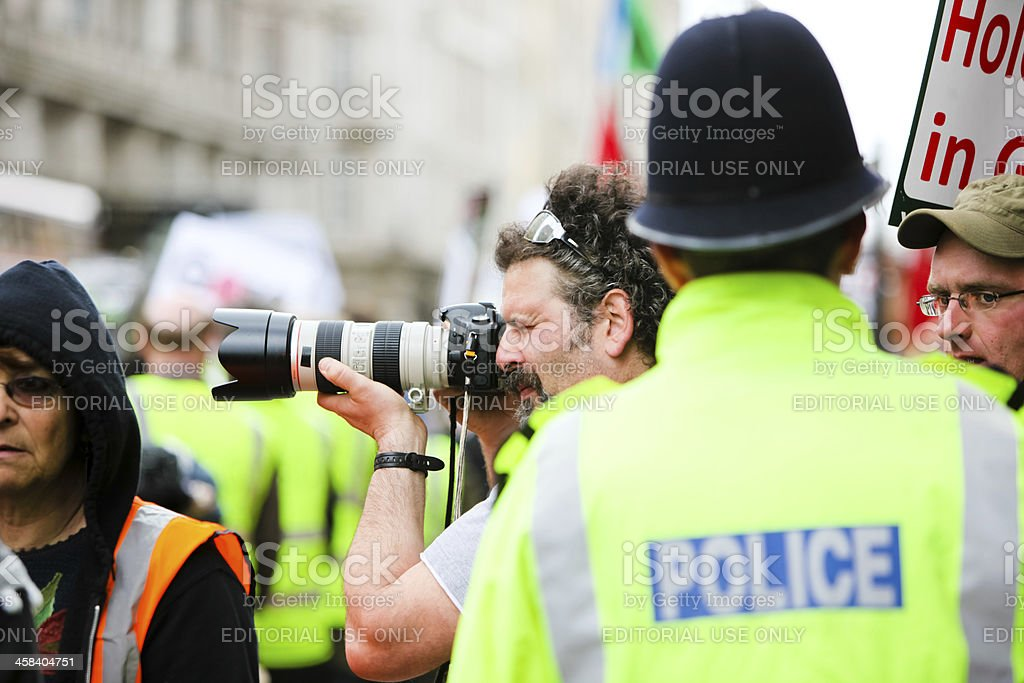 Photographer and Policeman stock photo