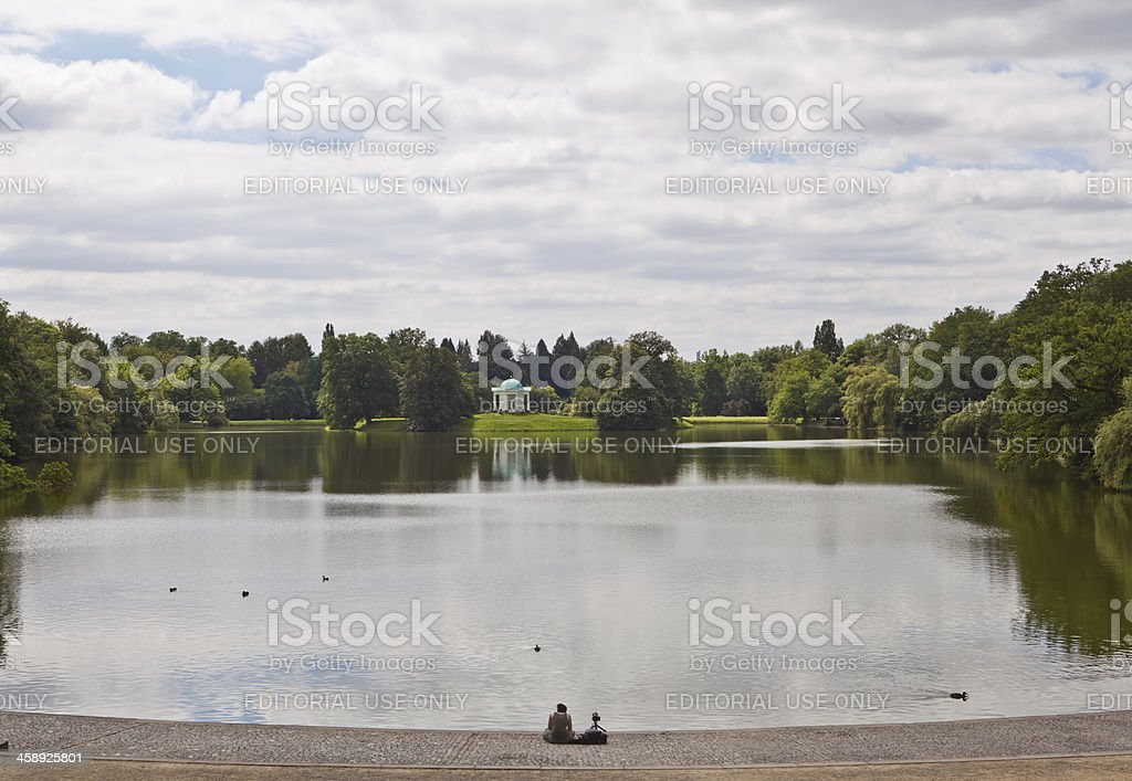 photographer at a pond stock photo