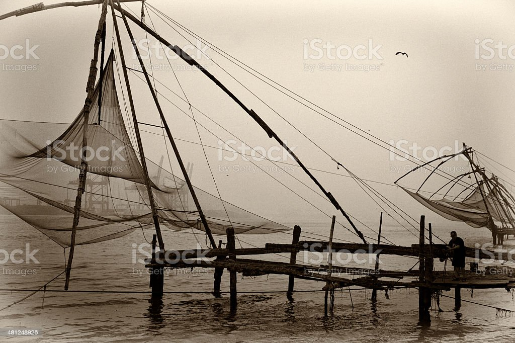 Photographer at dawn in Cochin. stock photo
