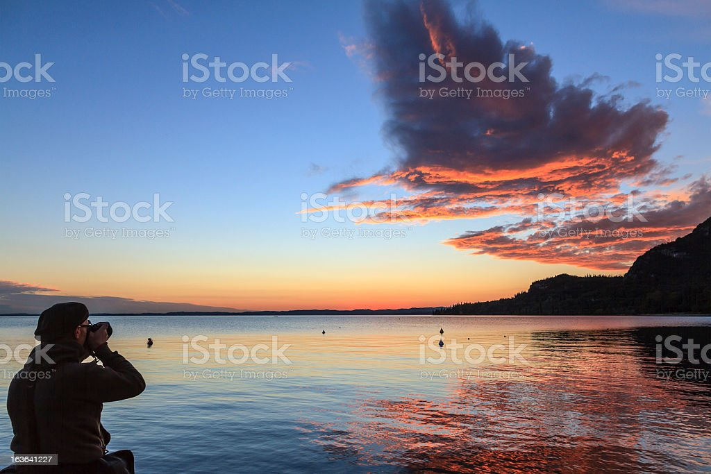 Photographer at Lake Garda, Italy royalty-free stock photo