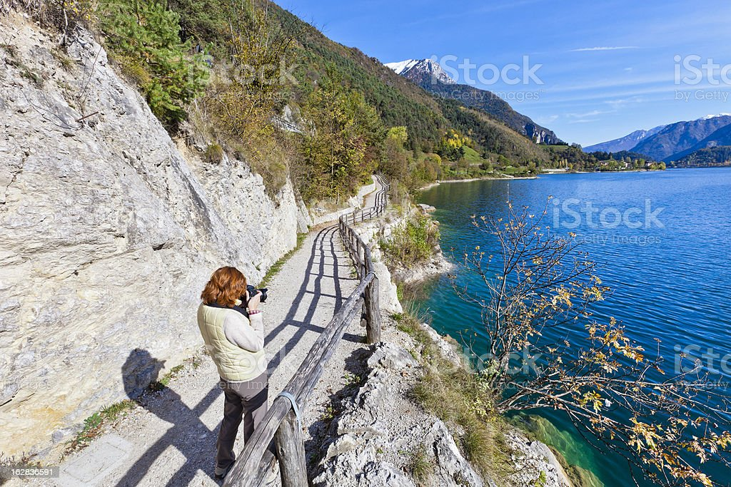 Photographer At Lake Ledro stock photo