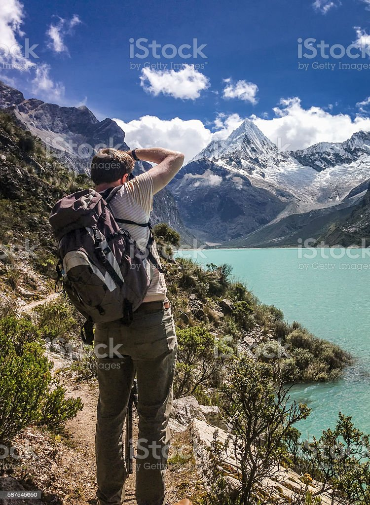 Photographer At Lake Paron In Peru stock photo