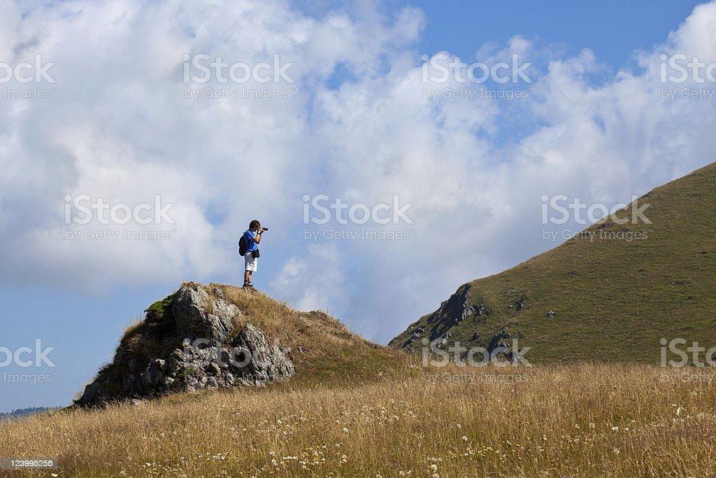 Photographer at mountain stock photo