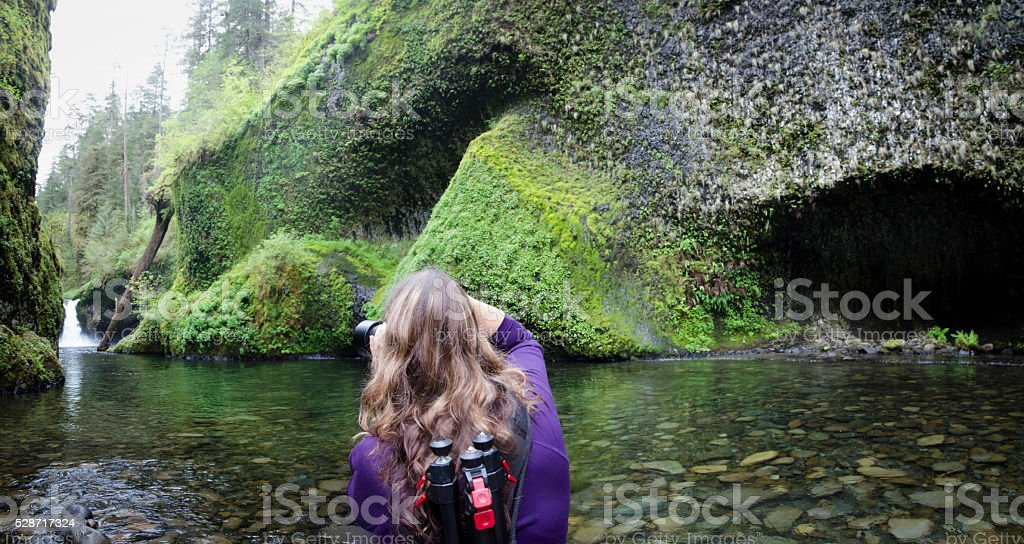 Photographer at Punchbowl Falls stock photo
