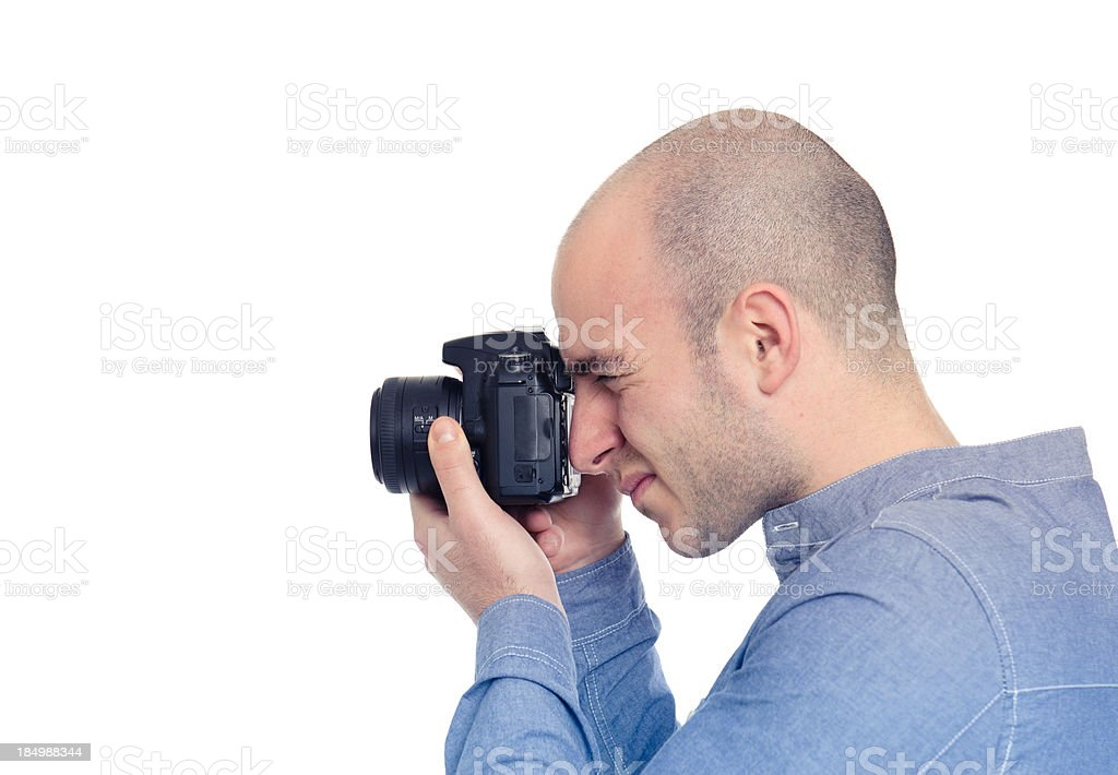 Photographer at work, isolated on white stock photo