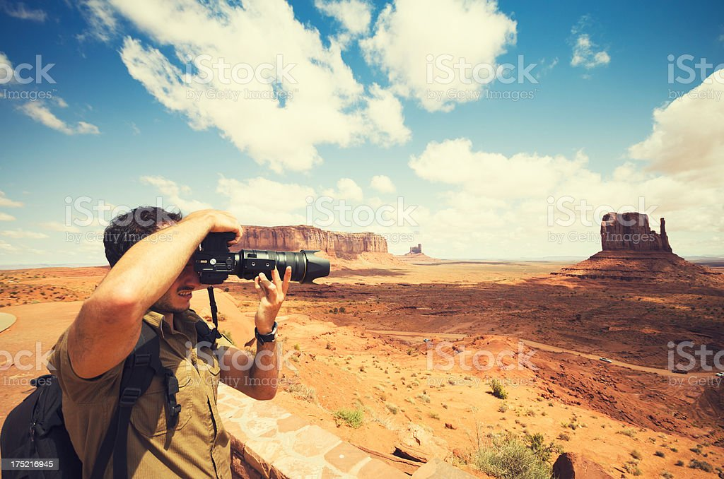 Photographer at work on Monument Valley tribal navajo National park royalty-free stock photo