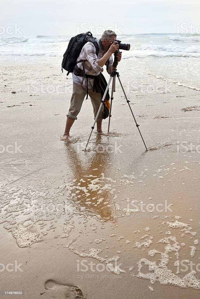 Photographer Barefoot in Atlantic Ocean Morocco royalty-free stock photo