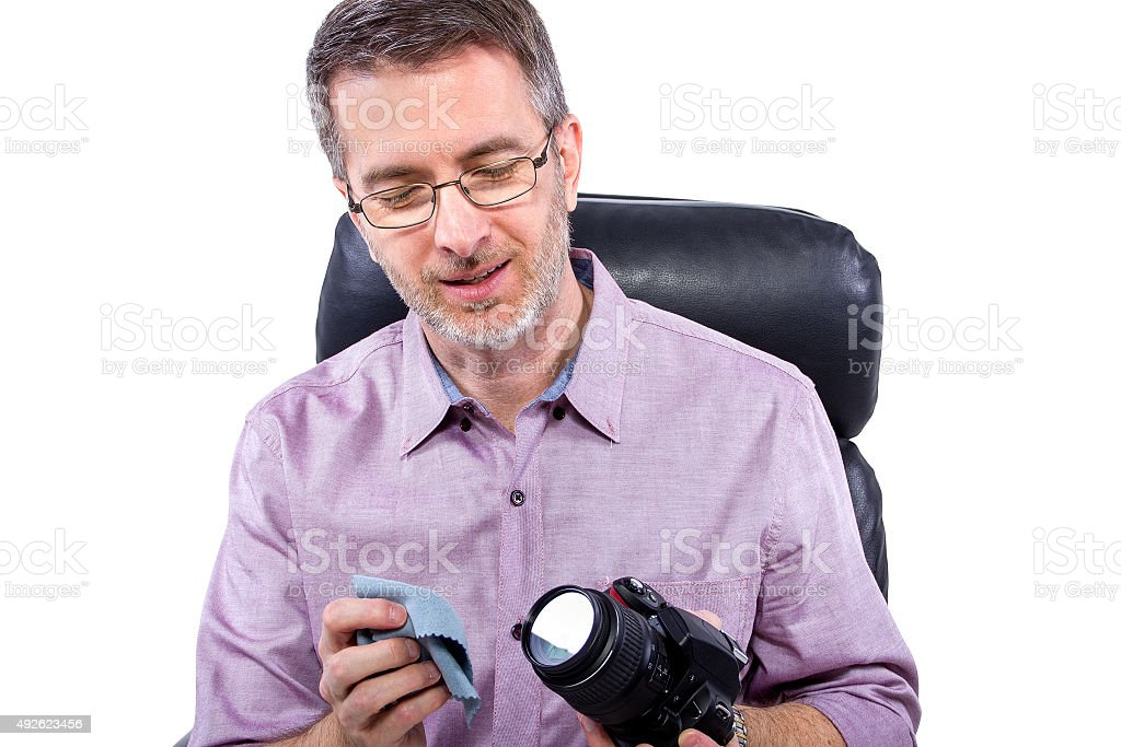 Photographer Cleaning Gear stock photo