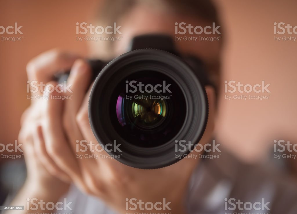 Photographer doing self portrait. stock photo