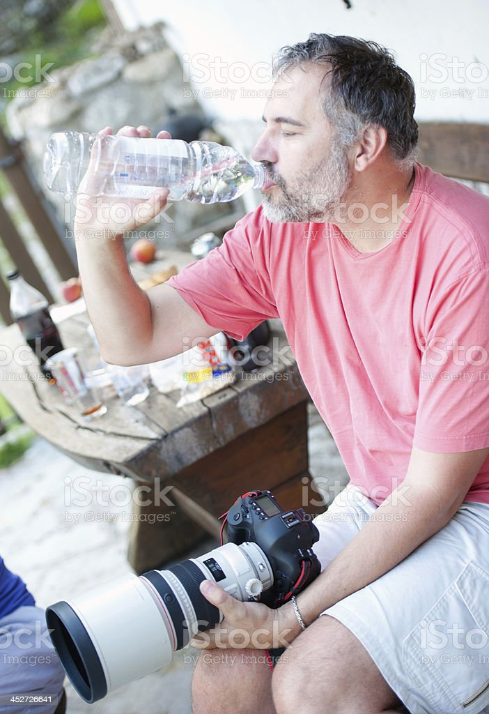 Photographer drinking water royalty-free stock photo