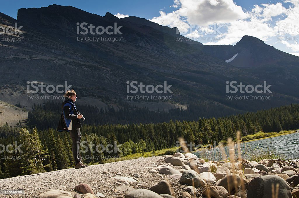 Photographer Enjoying Outdoors by Mountains royalty-free stock photo
