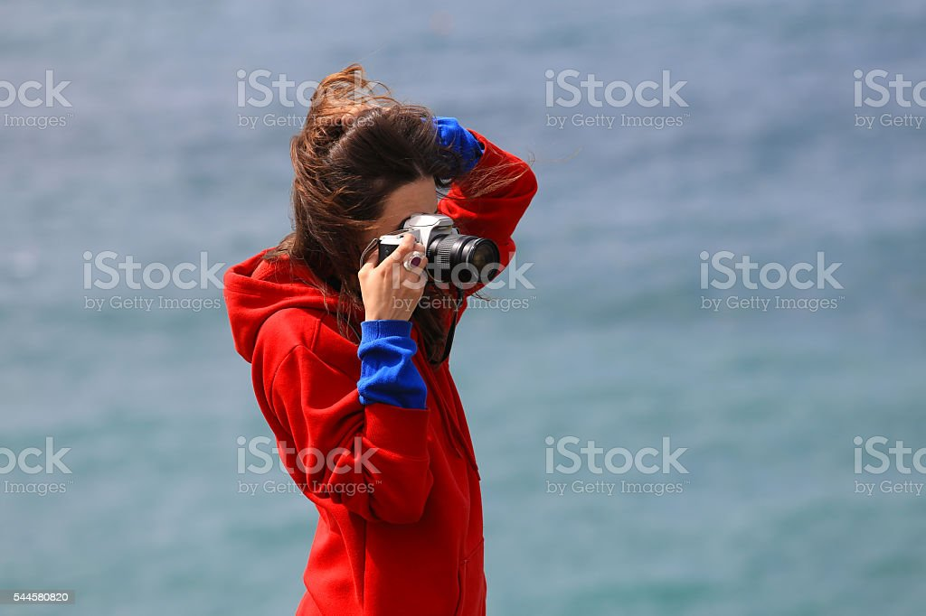 Photographer girl on sea background stock photo