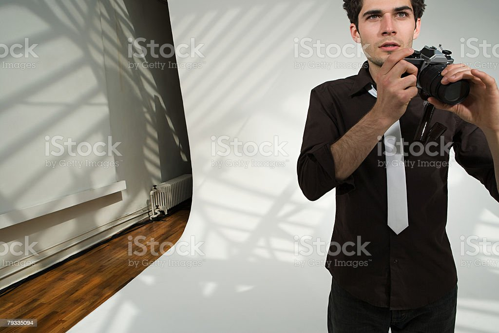 Photographer holding a broken camera stock photo