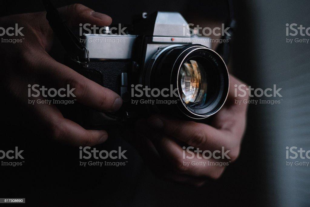 Photographer holding a vintage camera stock photo