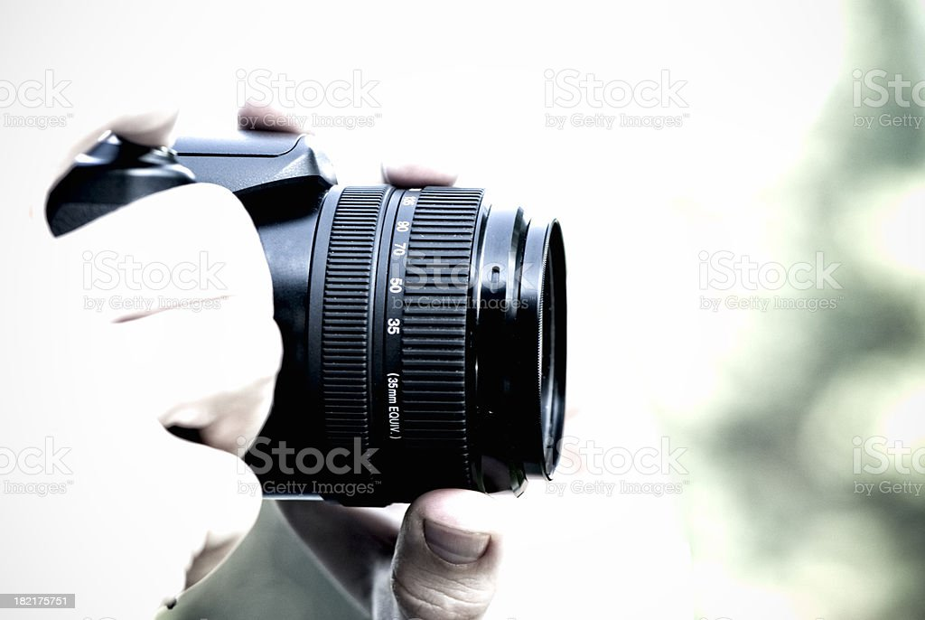 Photographer holding professional camera, high key, copy space royalty-free stock photo