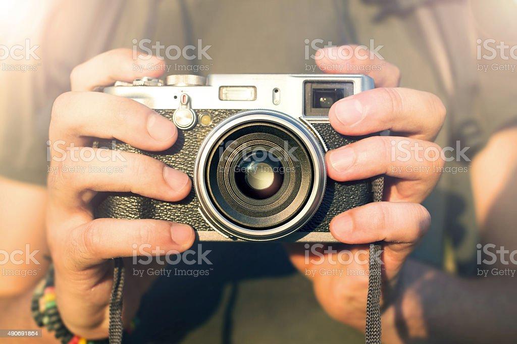 photographer holding vintage reportage camera stock photo