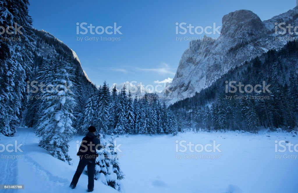 Photographer in a Winter Landscape stock photo