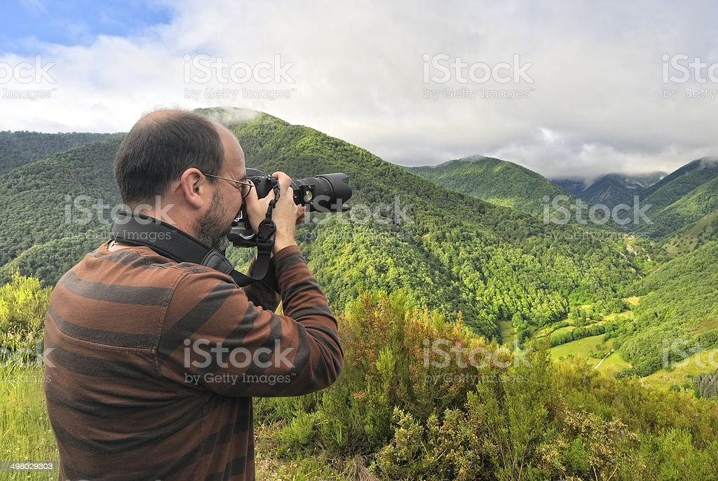 Photographer in forest. stock photo