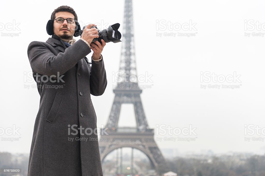 Photographer in front of Eiffel Tower stock photo