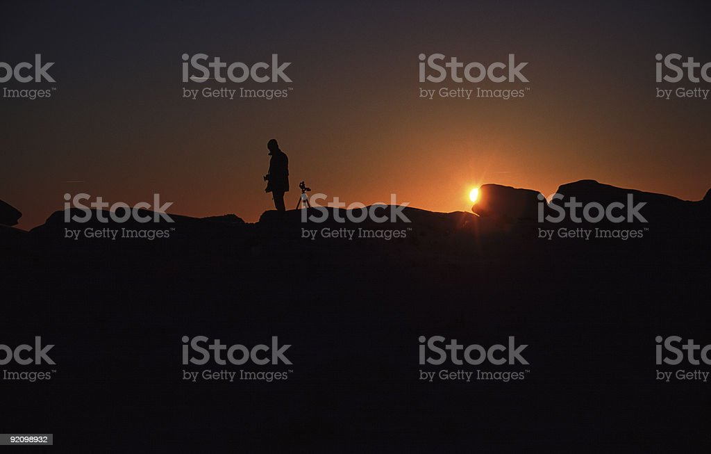 Photographer in silhouette royalty-free stock photo