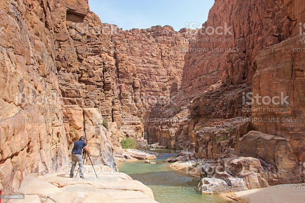 Photographer in the Wadi AL Mujib stock photo