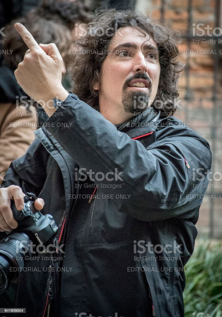 Photographer in Venice directing his subject stock photo