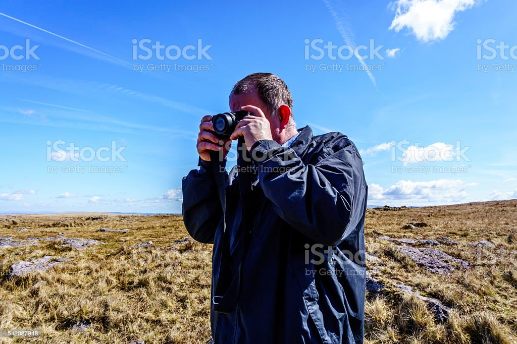 Photographer in Welsh countryside stock photo
