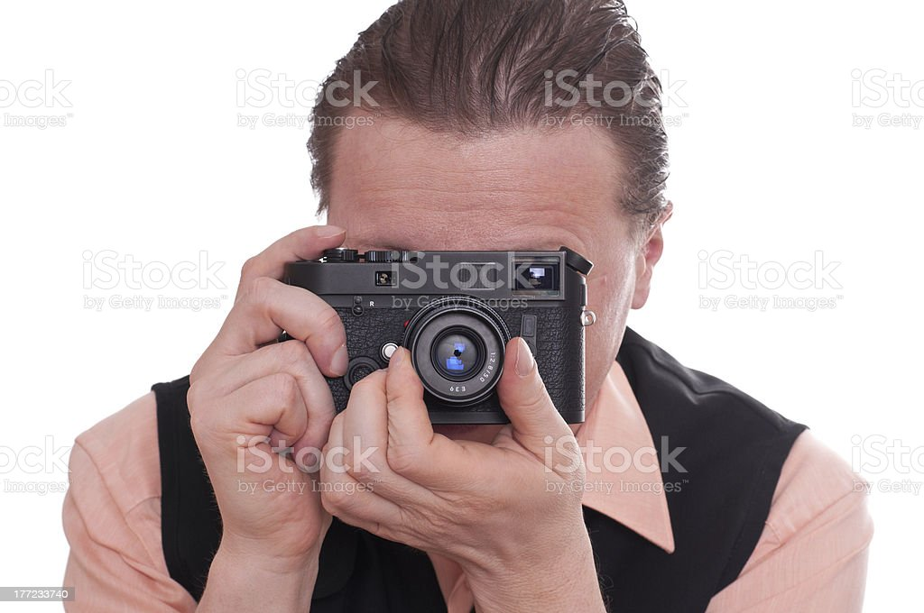 Photographer is focusing a rangefinder camera stock photo