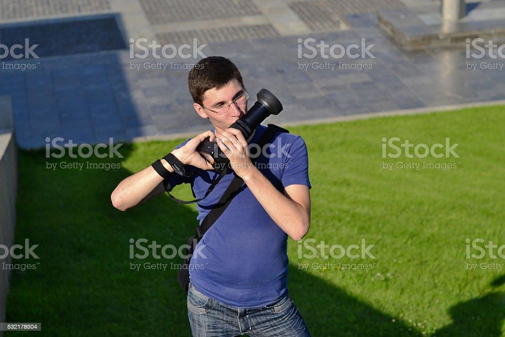 Photographer kissing camera stock photo
