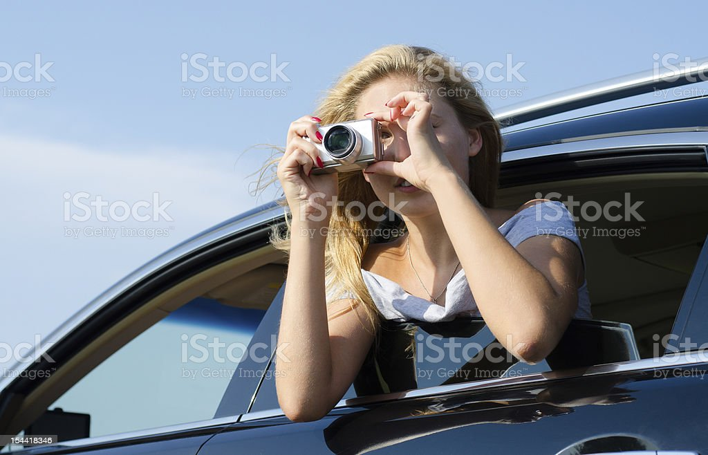 Photographer leaning out of car window royalty-free stock photo