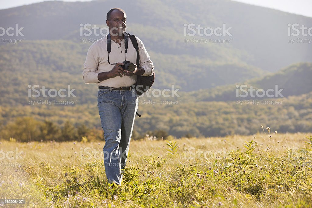 Photographer looking for his Shot royalty-free stock photo