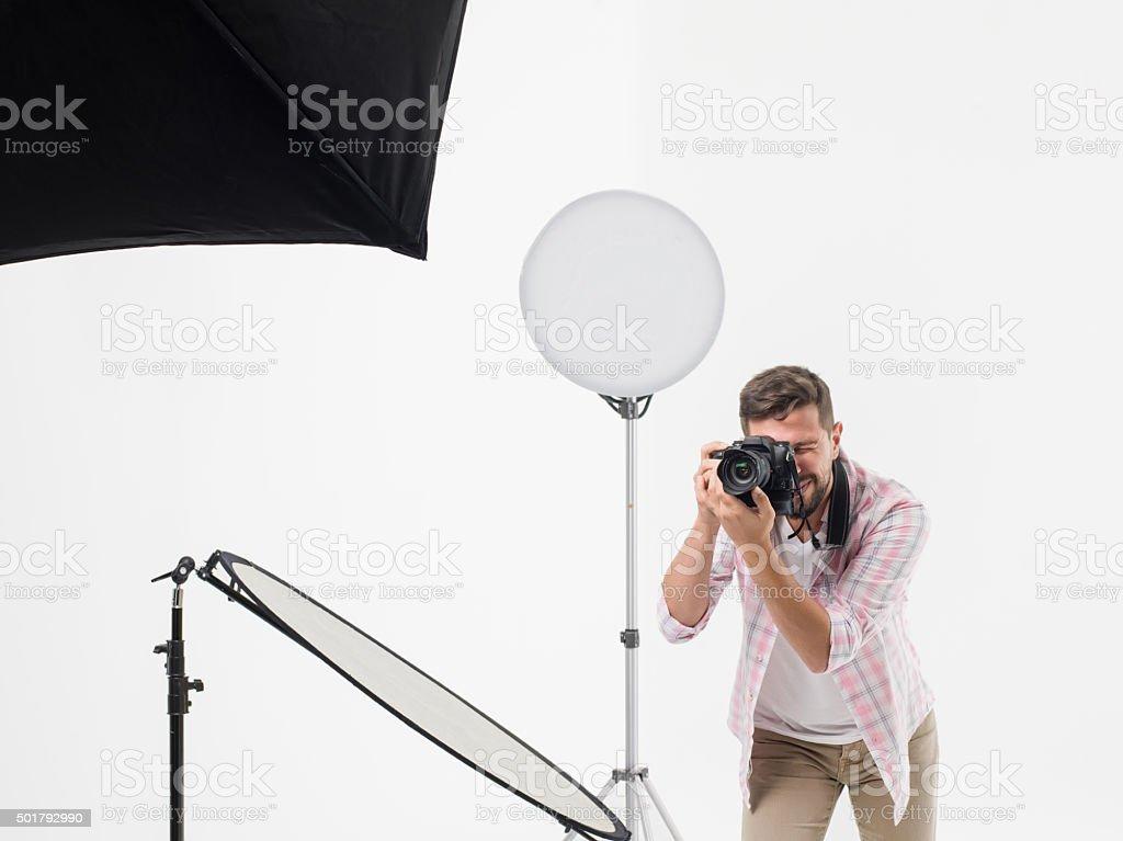 Photographer man photo shooting in studio stock photo