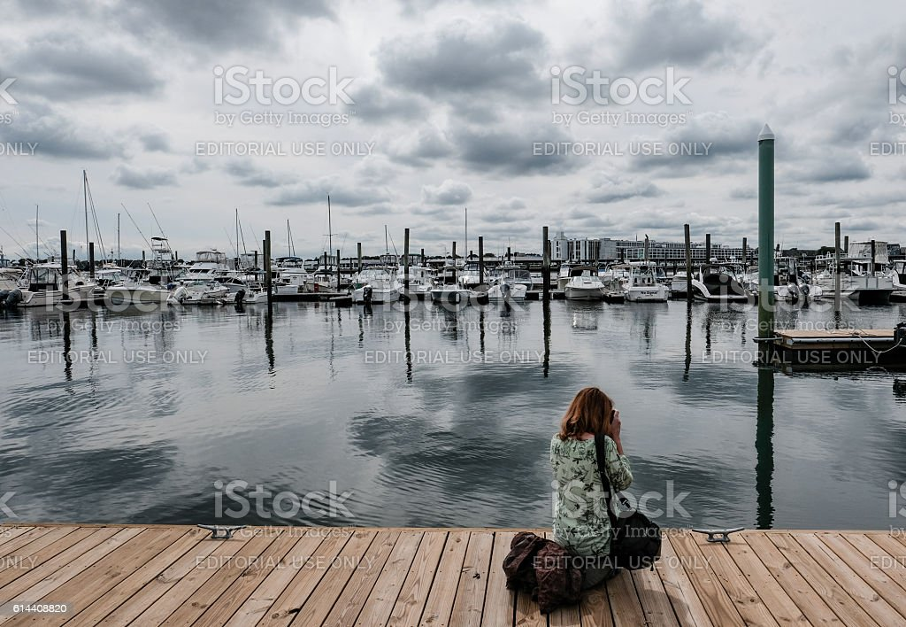 Photographer On A Jetty In Historic Salem, MA, USA stock photo